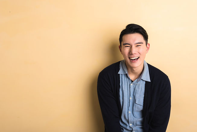 Asian young man laughing in the studio y