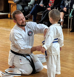 Sensei and student belt ceremony karate