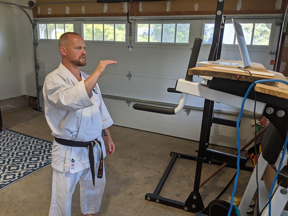 Sensei Black Belt teaches karate zoom class in garage gym dojo