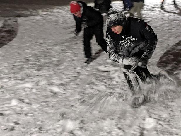 Outdoor wrestling practice in the snow