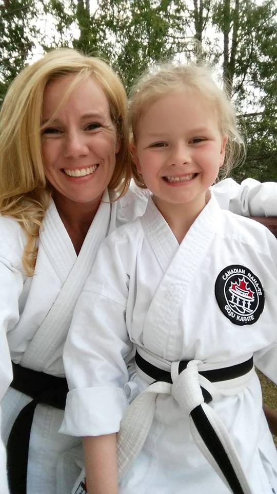 Female Black belt and female white belt child karate