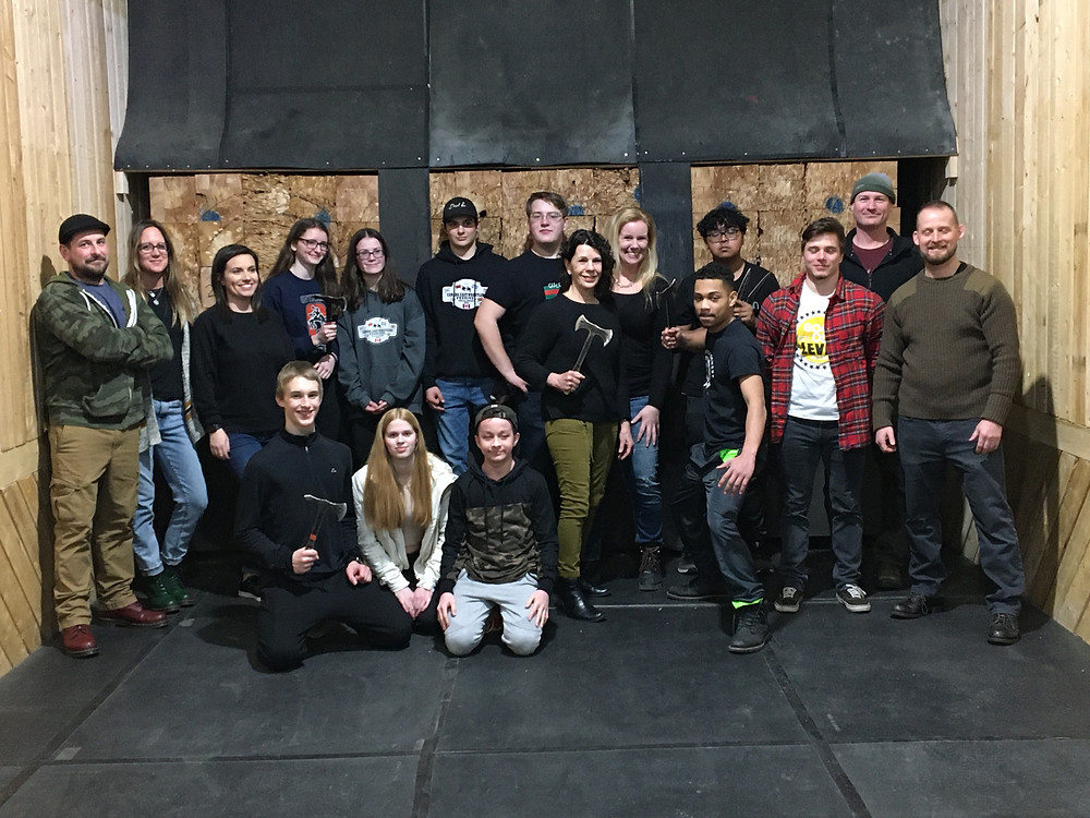 Wrestling team poses for group photo at axe throwing event