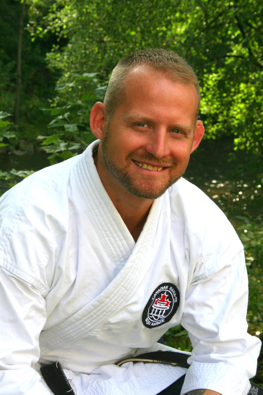 Sensei Tom Cako, black belt, 6th Dan