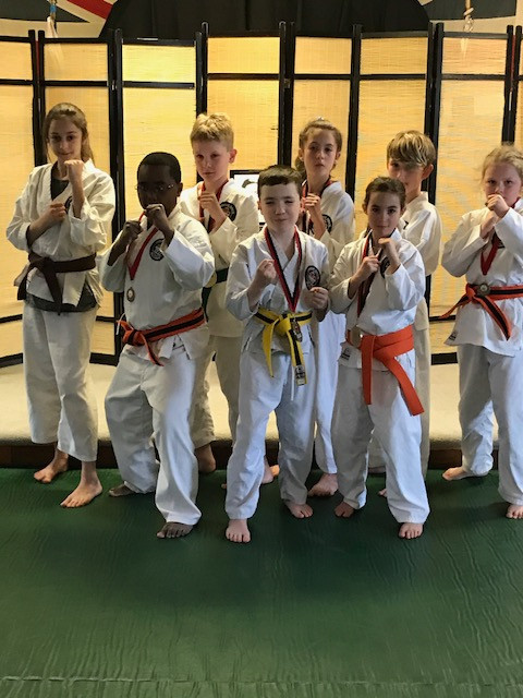 Tri-City Training students display their karate medals