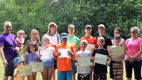 youth wrestling and karate campers pose with camp completion certificates