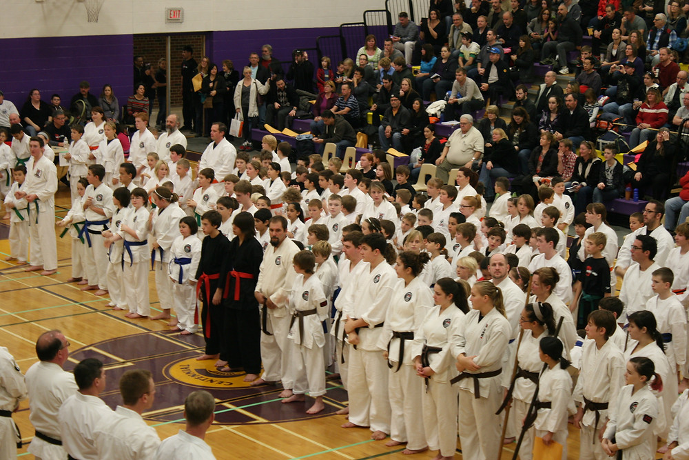 Black Belts and Karate students await opening ceremonies for Karate Tournament
