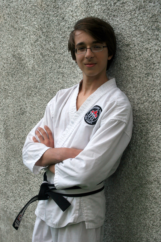 New Sensei with black belt in karate portrait
