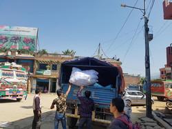 loading van w/ rice & blankets