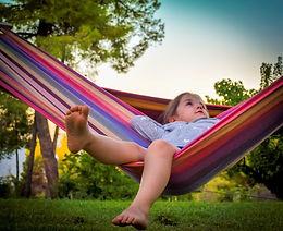 Image of kid in hammock Image by Daniela Dimitrova from Pixabay