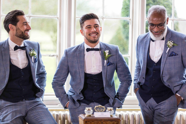 groom and best man wearing tweed