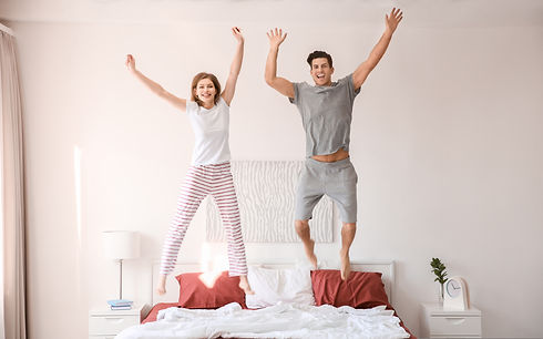 happy well rested couple, bedroom, slept well feeling great