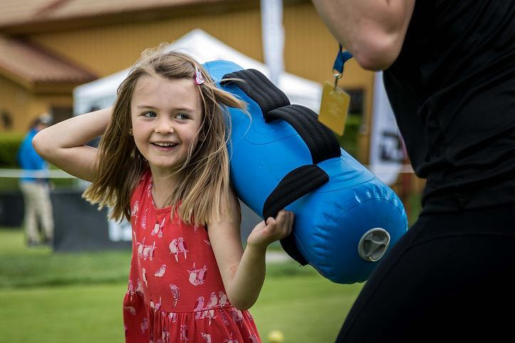 Child smiling while training with Aquabag
