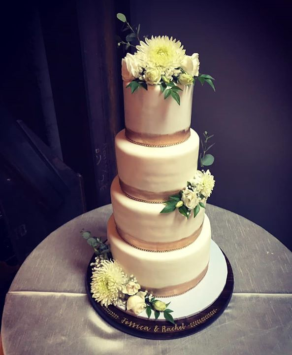 4 tier gold band wedding cake