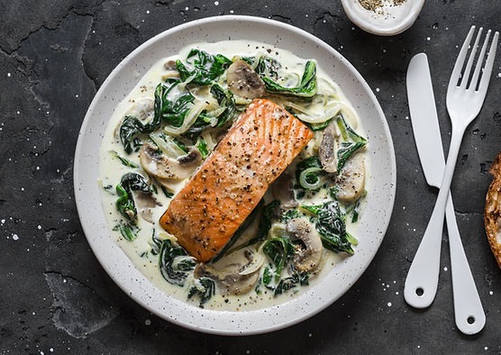 Pan fried salmon on a bed of wilted spin