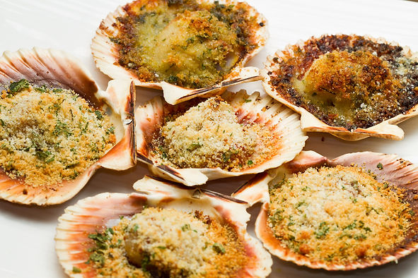 Scallops with a herb and parmesan crust.