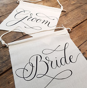bride and groom fabric chair signs.jpg