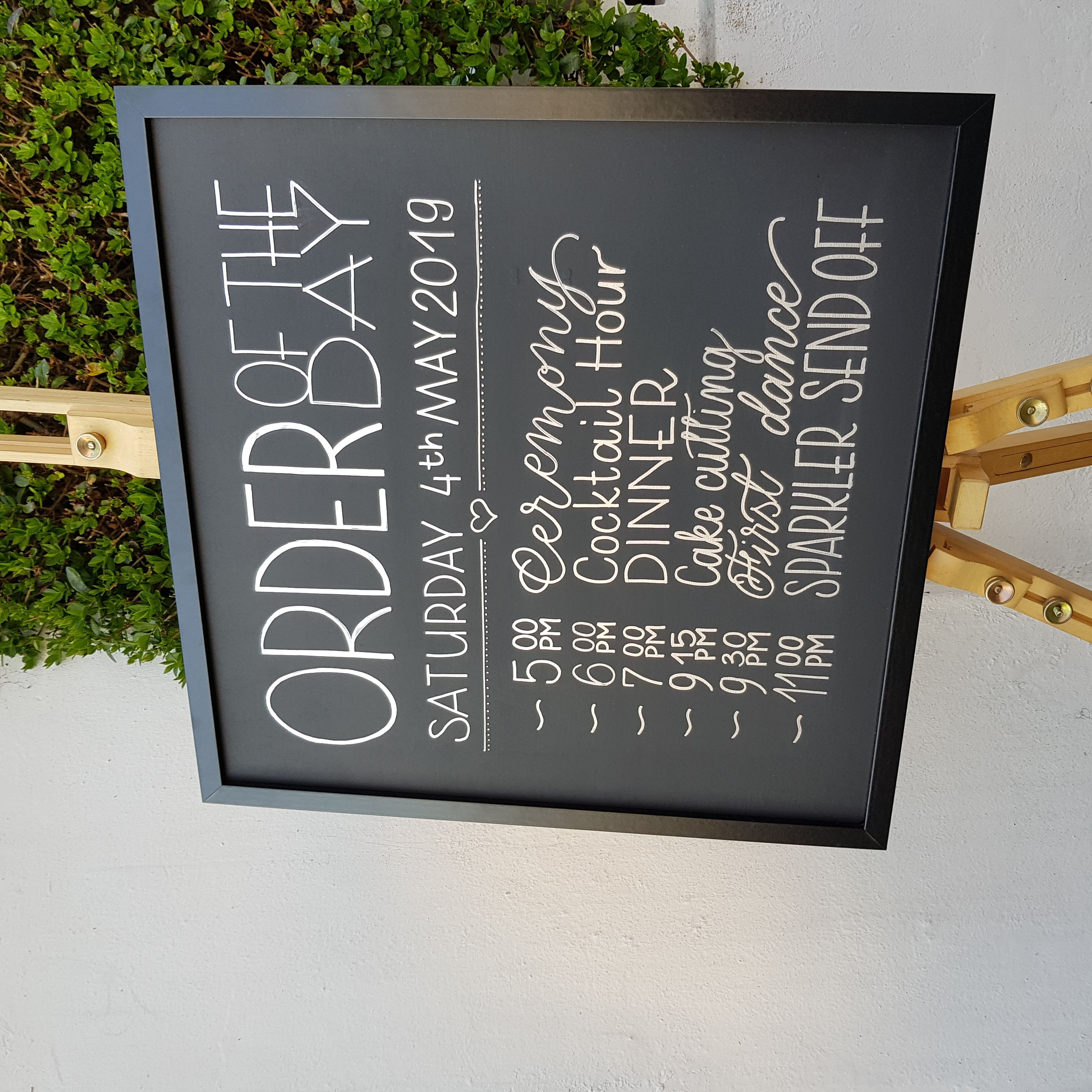 order of the day blackboard sign
