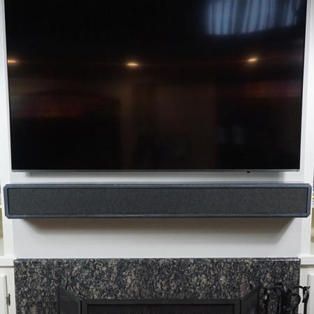 firesounds concrete mantel with integrated soundbar speaker