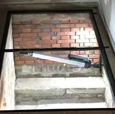 Trappe vitrée motorisée