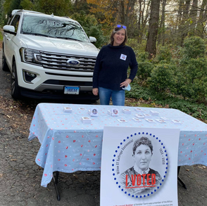 """Pamela Hovland and Vanessa Elias give out """"I Voted"""" stickers honoring Connecticut suffragists and the 100th anniversary of the passage of the 19th Amendment (11/3/20 The Wilton Bulletin)"""