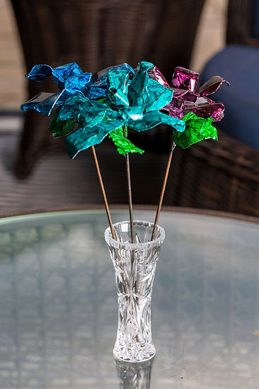 Blue, Teal, & Purple Roses Bouquet in Crystal Vase on Glass Patio Table