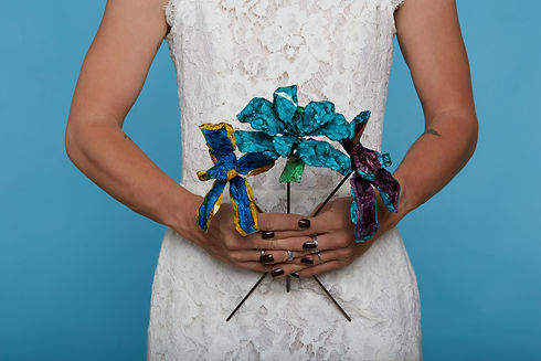 Blue Yellow Orchid, Teal Rose, & Purple Teal Orchid Forever Wedding Bouquet Held By Wedding Model