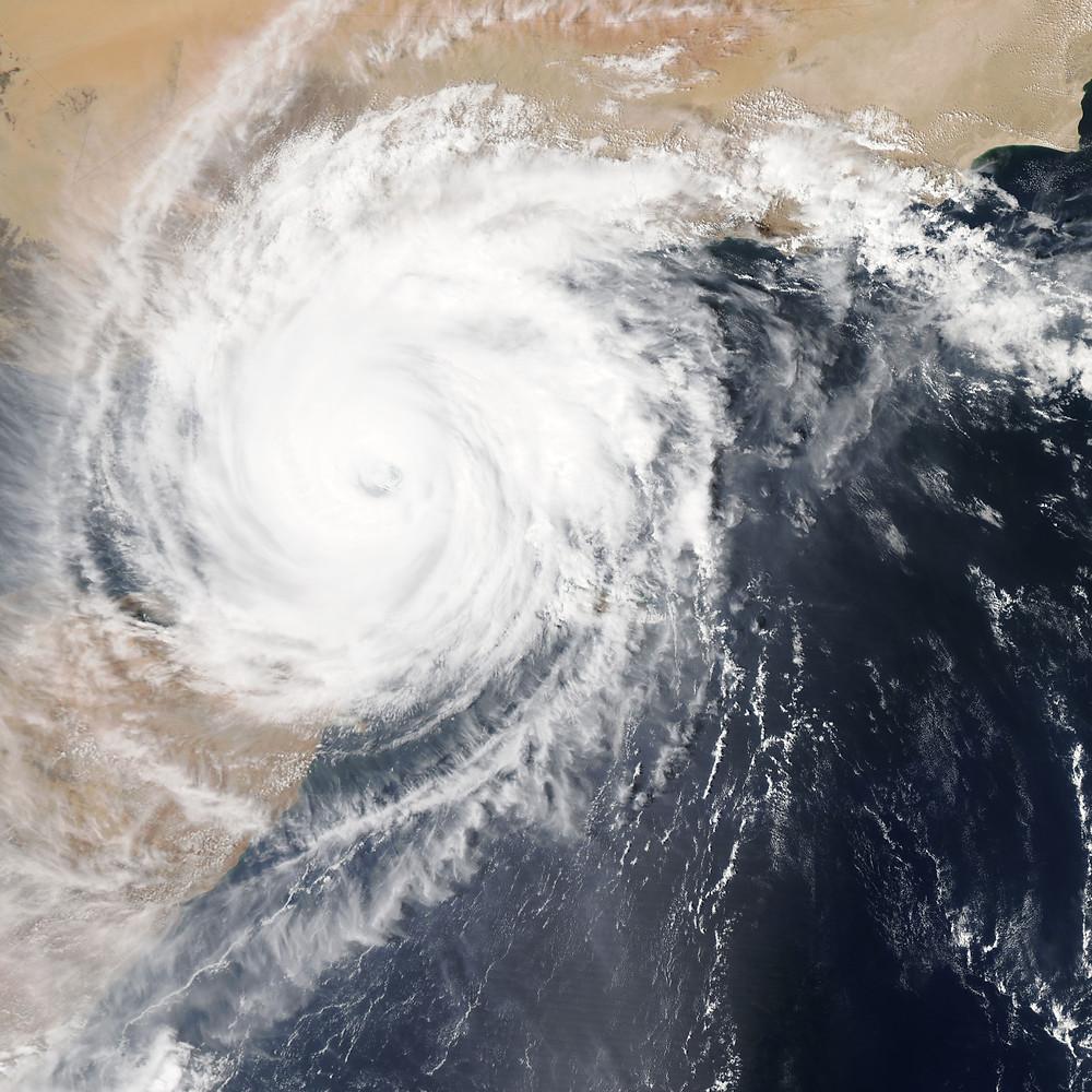 satellite image of a hurricane, by NASA