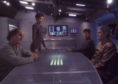 Scene from Star Trek Enterprise showing Dr. Phlox, T'Pol, and two Vulcan medical researchers