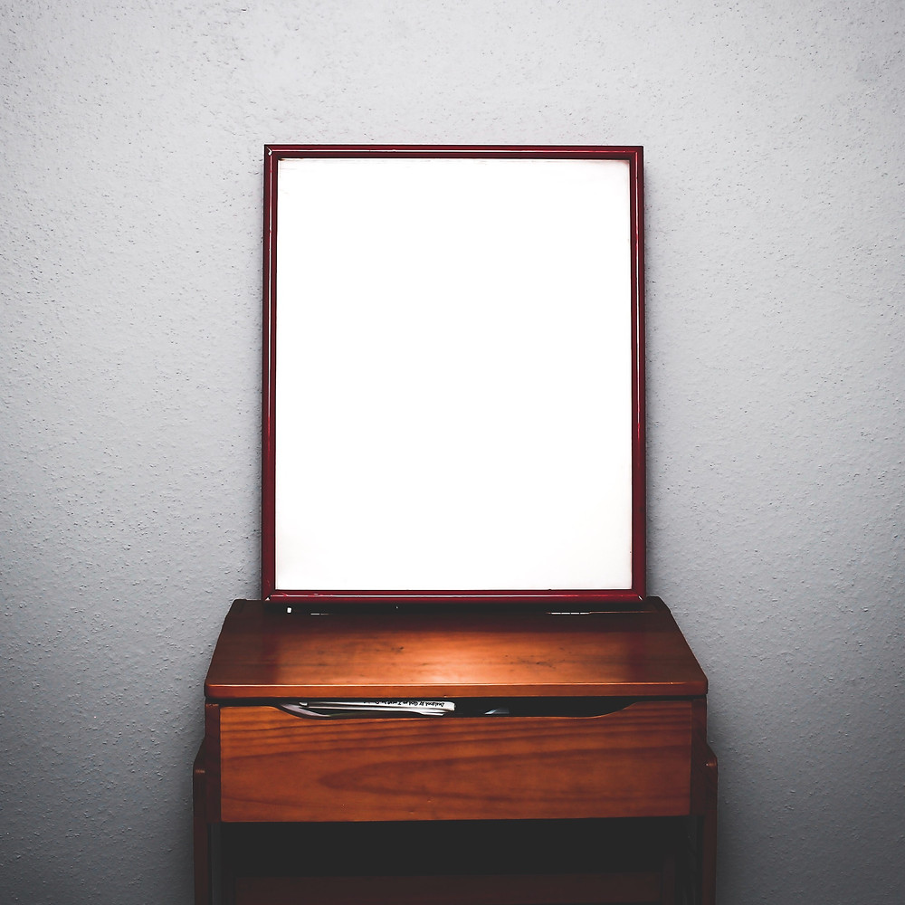 piece of furniture with a large mirror