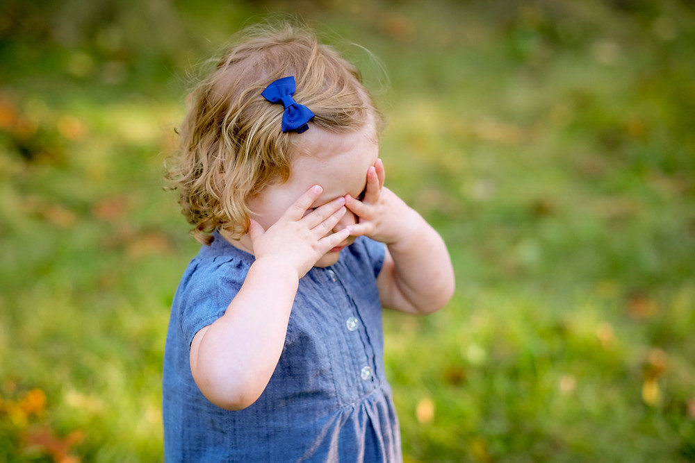 Shy toddler during family photo session Belleville