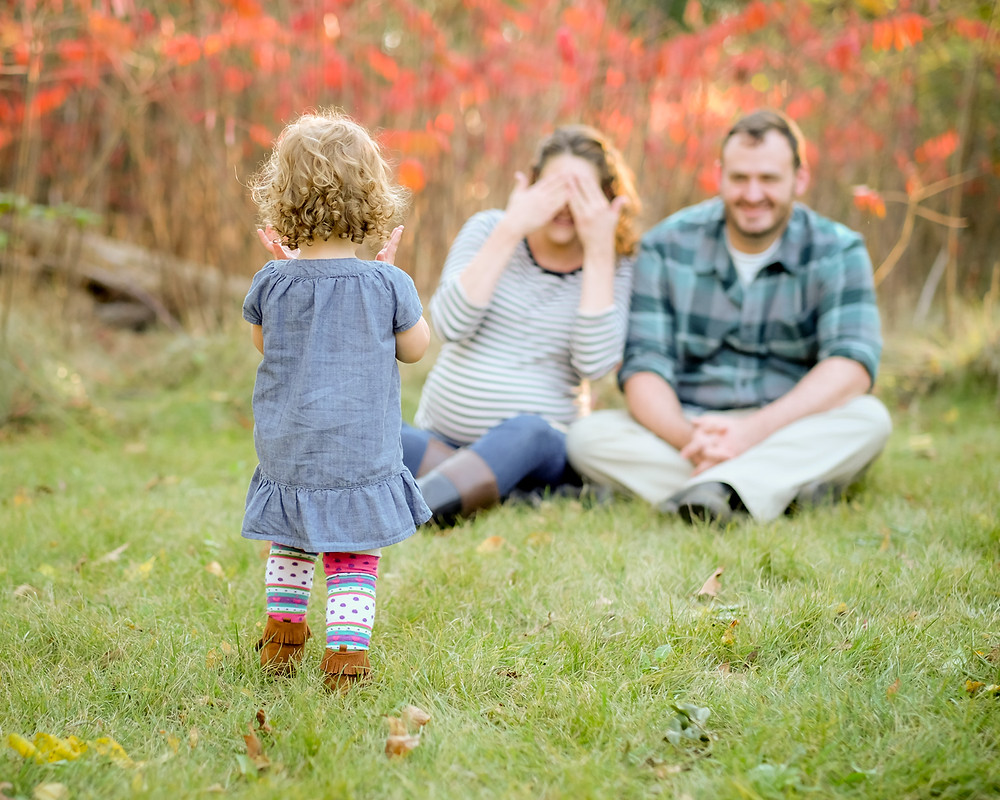 Playing games with toddlers during family photos
