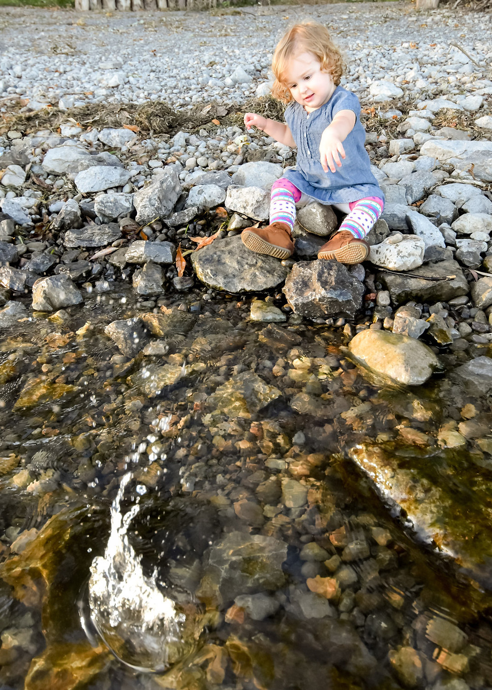 Girl throwing rocks in Bay of Quinte Conservation Area