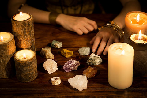 a lot of healing stones, candles and for