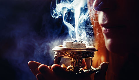incense in a woman hand, incense smoke o