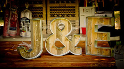 marquee letters on the rustic bar