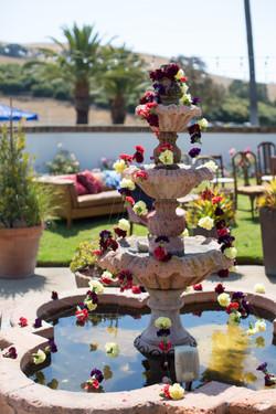 Flower garland on courtyard fountain