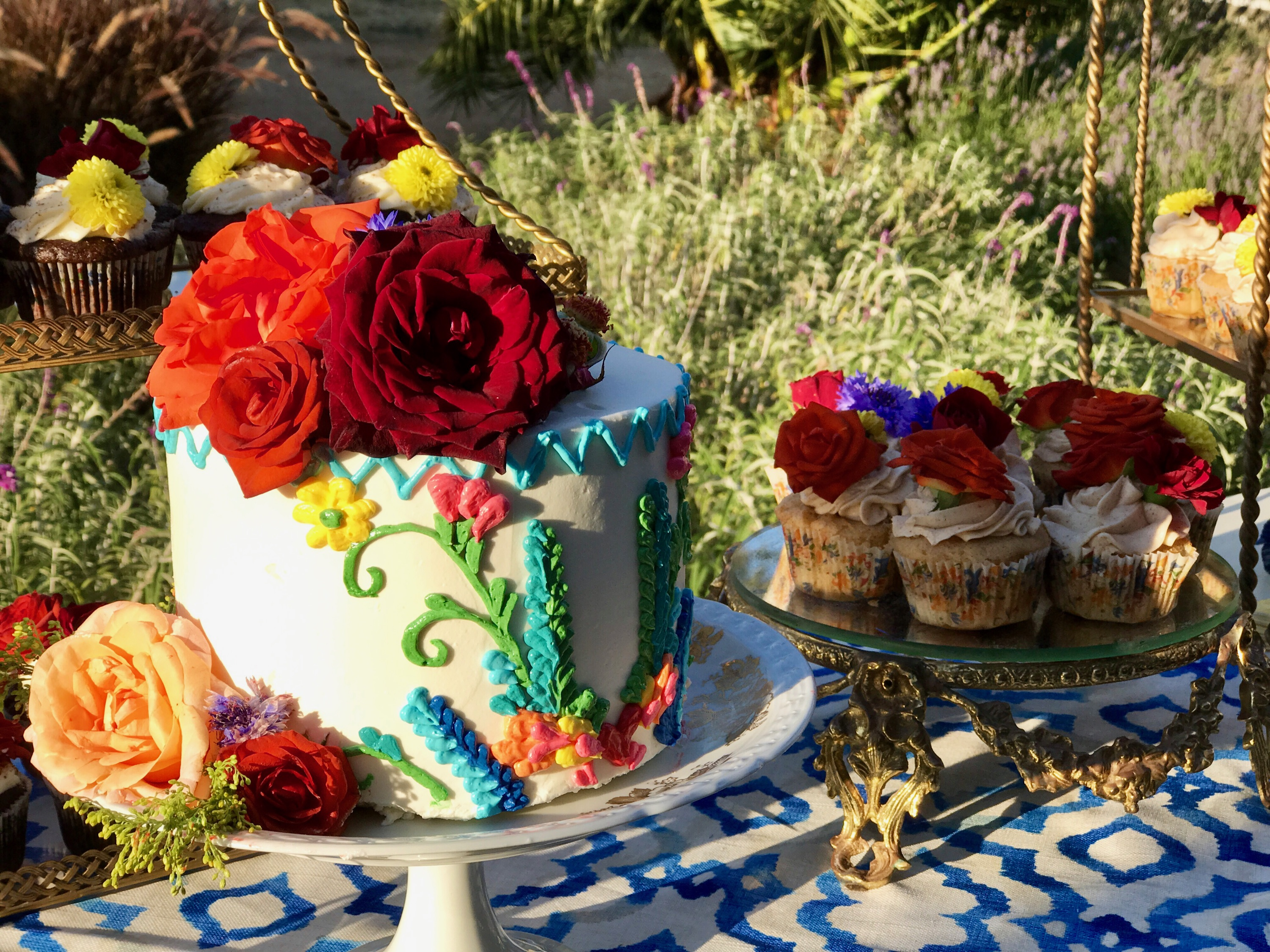 Colorful cake and cupcakes