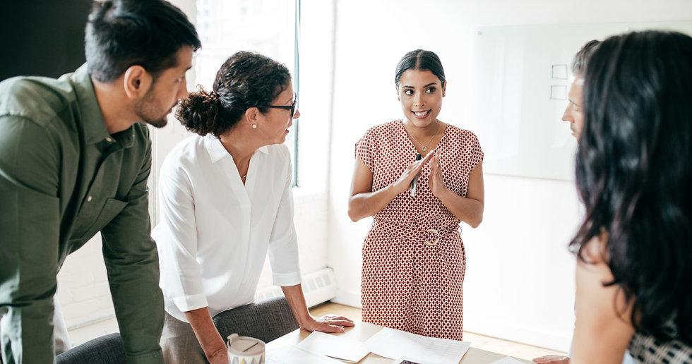 Female Leader Talking To Team