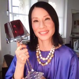 Lucy Liu holding Trophy.jpg