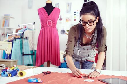 Woman Measuring Material in Studio