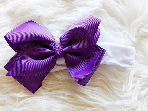 Big purple ribbon on white nylon