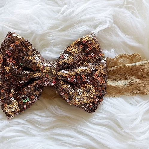 Rose gold sequin bow on lace