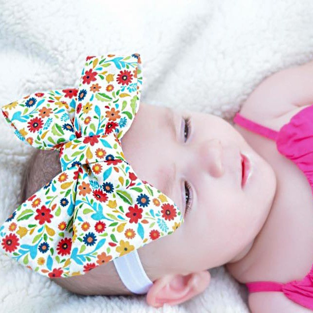 Gorgeous bow on a gorgeous little girl! Our summer floral bow now in the shop! Go get it now, spend