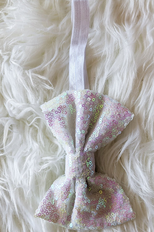 White sequin bow on band