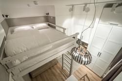 Кровать в семейном апартаменте студи
