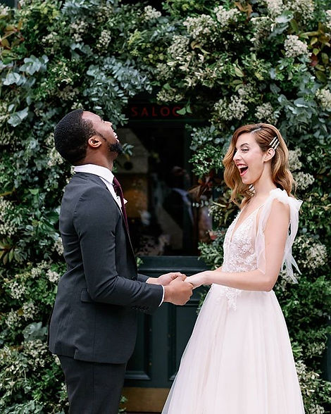 Bride-and-groom-laughing-enjoying-themselves-in-London-wedding