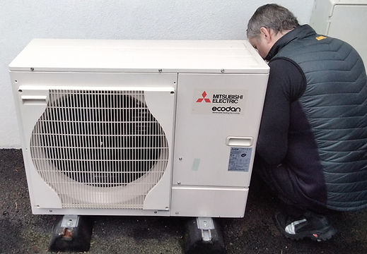 Robbie Devine, Aberdeen Air Source Heating, working on a Mitsubishi Ecodan air source heat pump