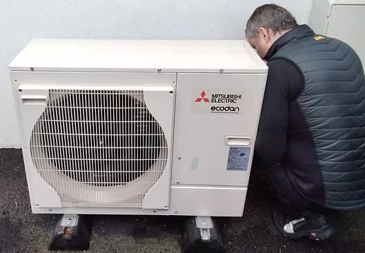 Man working on installation of air source heating