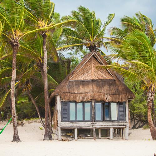 tropical-beach-house-on-ocean-shore-amon
