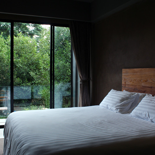 modern-bedroom-with-nature-view-PG33K4S.